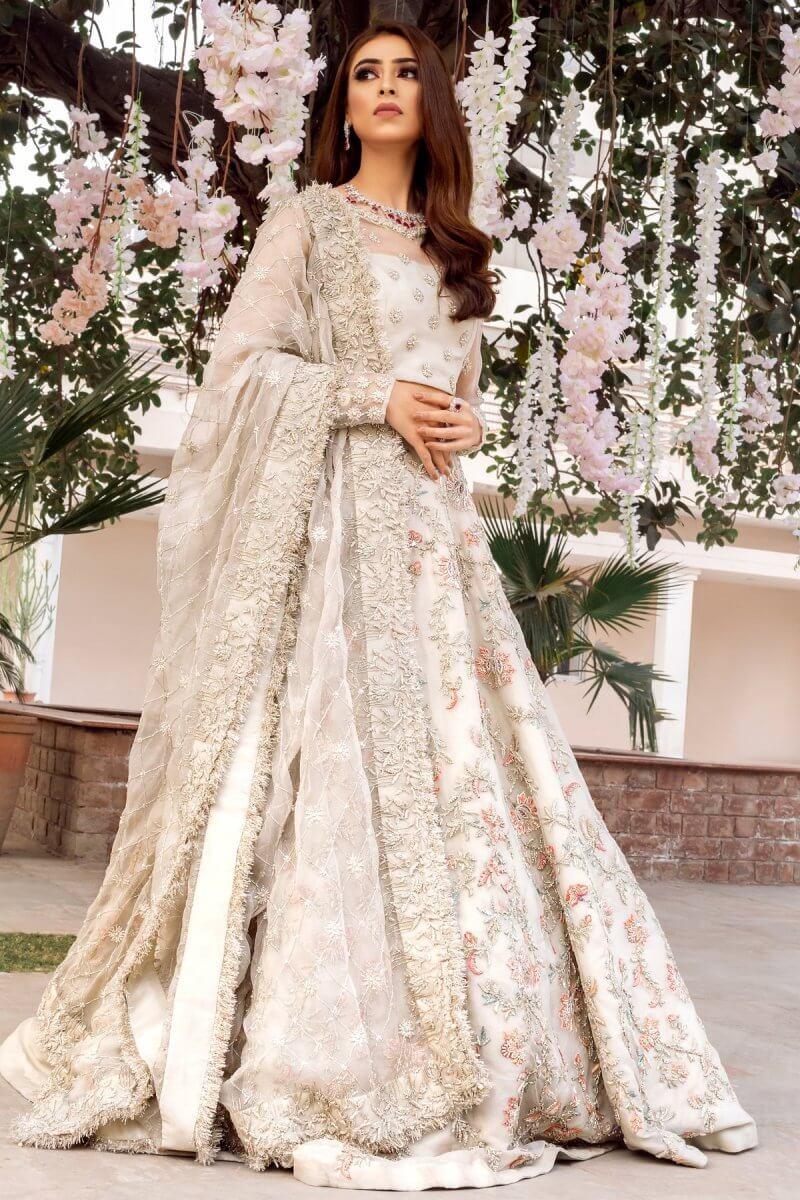 Ivory wedding dress with hand embellished lehnga , blouse and net dupatta