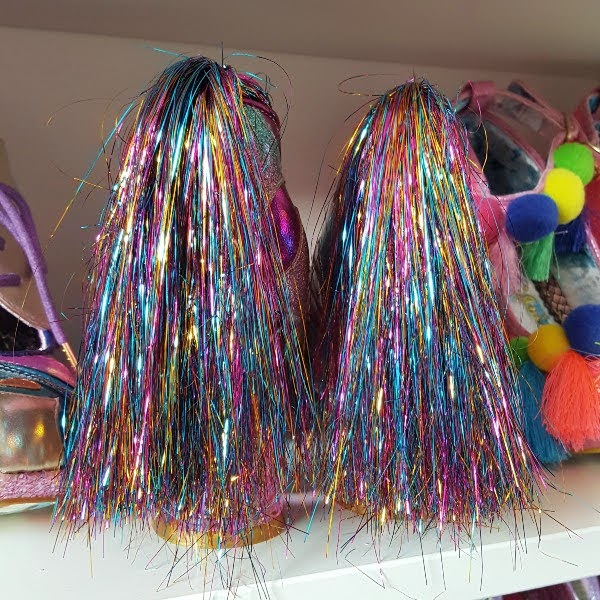 back of shoes with large pom pom tinsel multi coloured tails