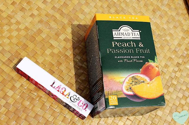 AHMAD TEA Peach & Passion Fruit Tea (about $2.80) LAQA & CO. Lip Lube Lip Pencil in Beezlebub ($20)