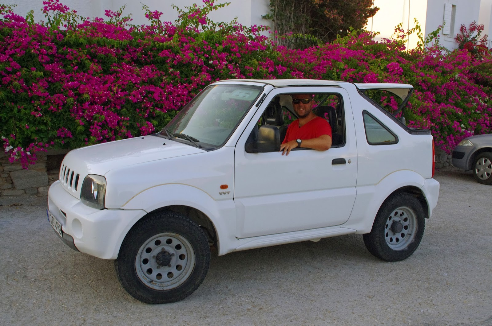 Male with Hire Car on Paros Greece