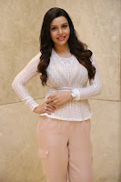 Kyra Dutt in Tight White Top Trousers at Paisa Vasool audio success meet ~  Exclusive Celebrities Galleries 008.JPG