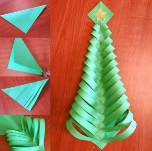 árbol de Navidad hecho con cuadrados de cartulina verde