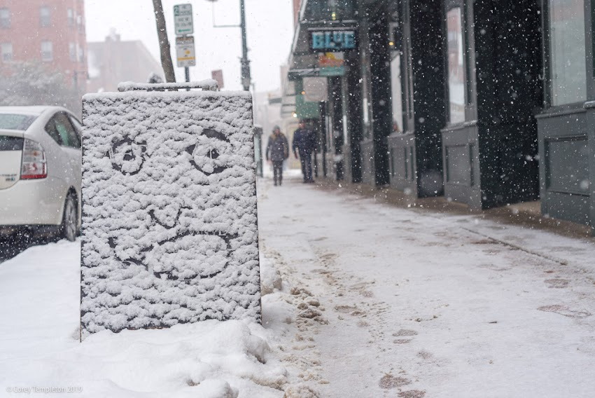 Portland, Maine USA March 2019 photo by Corey Templeton. A face in the snow on Congress Street.