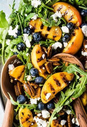 grilled peach and arugula salad with goat cheese and sweet honey balsamic dressing