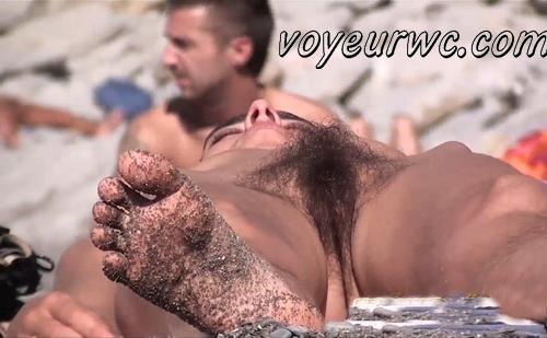 Nude sun tanning women a beach spy cam (BeachVoyeur 27-31)
