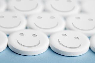 Multiple white happy faces