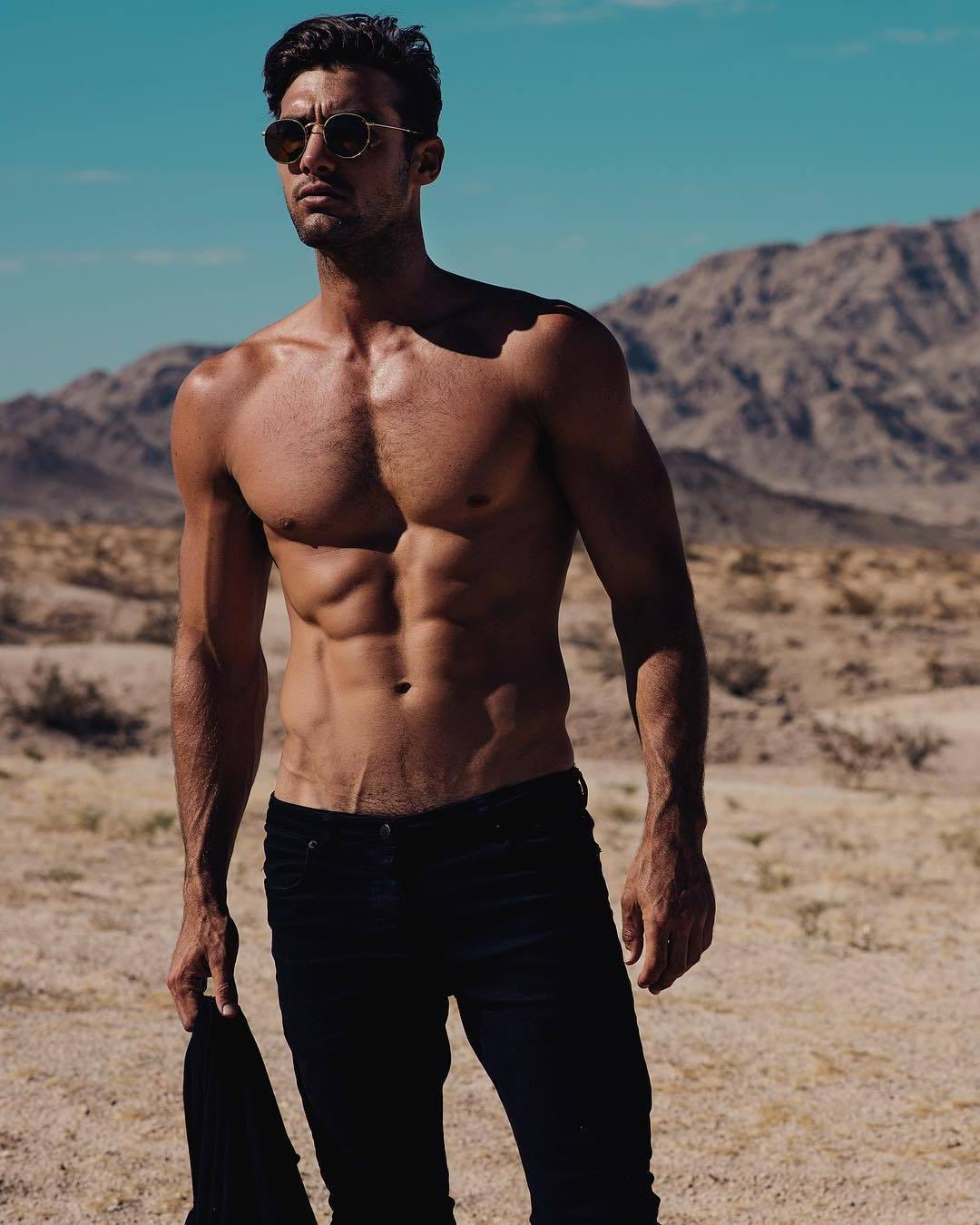 hot-shirtless-male-model-body-sunglasses-black-jeans-desert