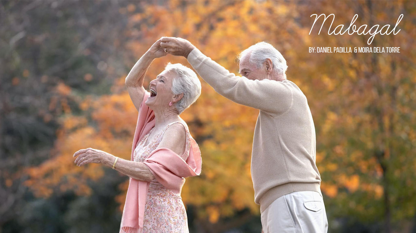 Old couple happily dancing