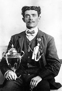 Dorando Pietri with the silver cup presented to him by Queen Alexandra