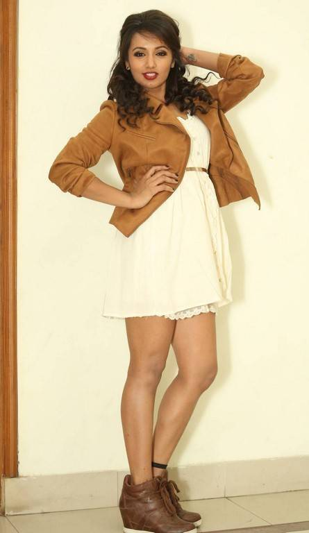 Telugu Hot Girl Tejaswi Thighs Legs Show In White Skirt At Audio Launch