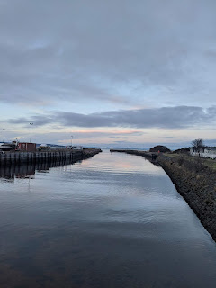 The River Nairn from the harbour with a view out to the sea