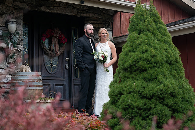 Bride and Groom together in front of farmhouse entrance Magnolia Farm Asheville Wedding Photography captured by Houghton Photography