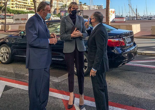 Princess Charlene wore a silk shirt by Brunello Cucinelli, turtleneck sweater and blazer by Loro Piana, ballerina flats by Louis Vuitton