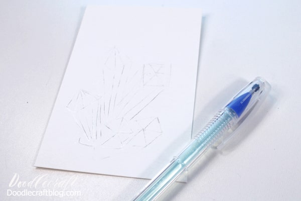 Use the glue pen as a watercolor resist for the watercolor galaxy crystals.