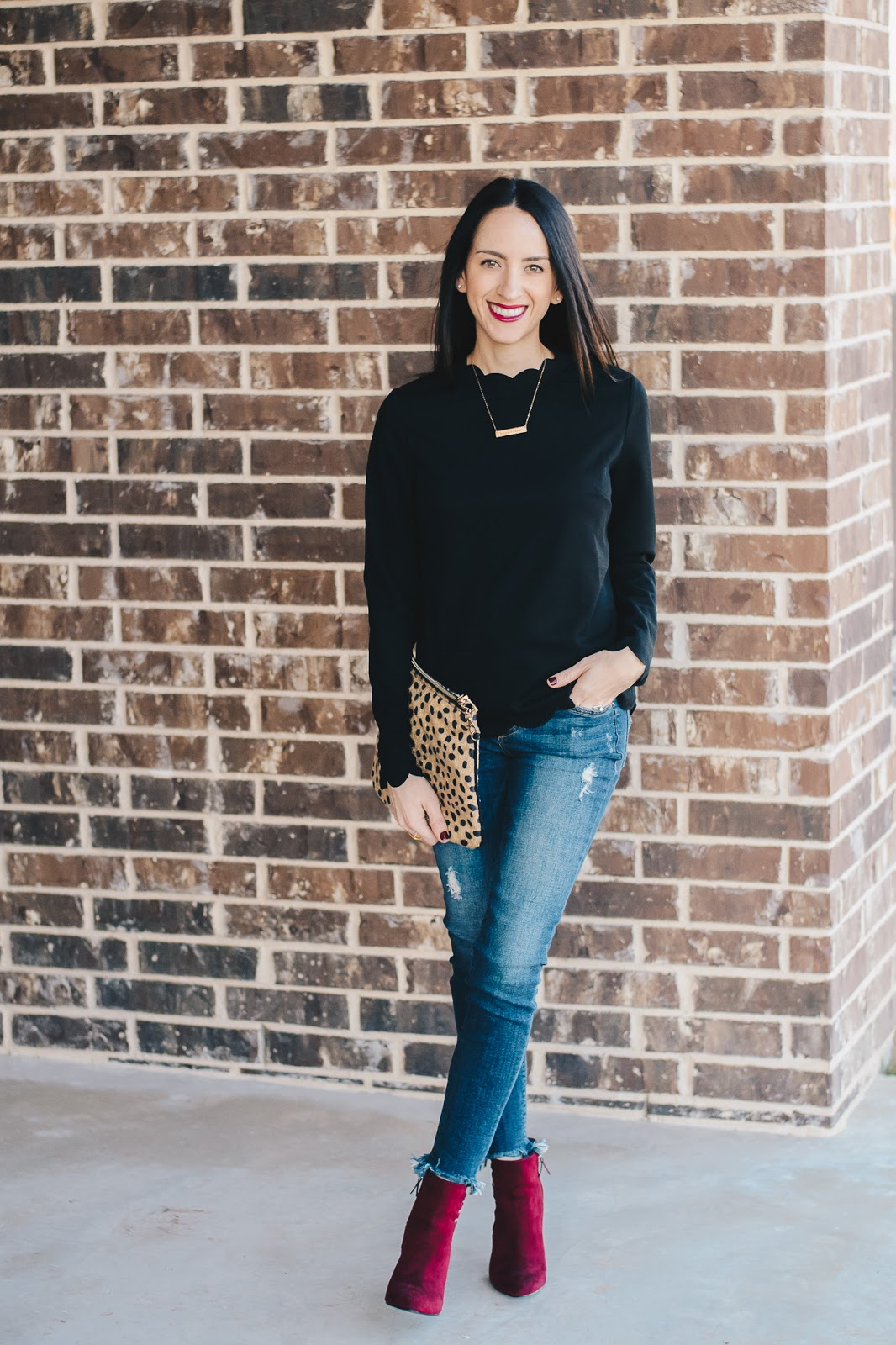 Holiday Style in black scalloped top and maroon booties
