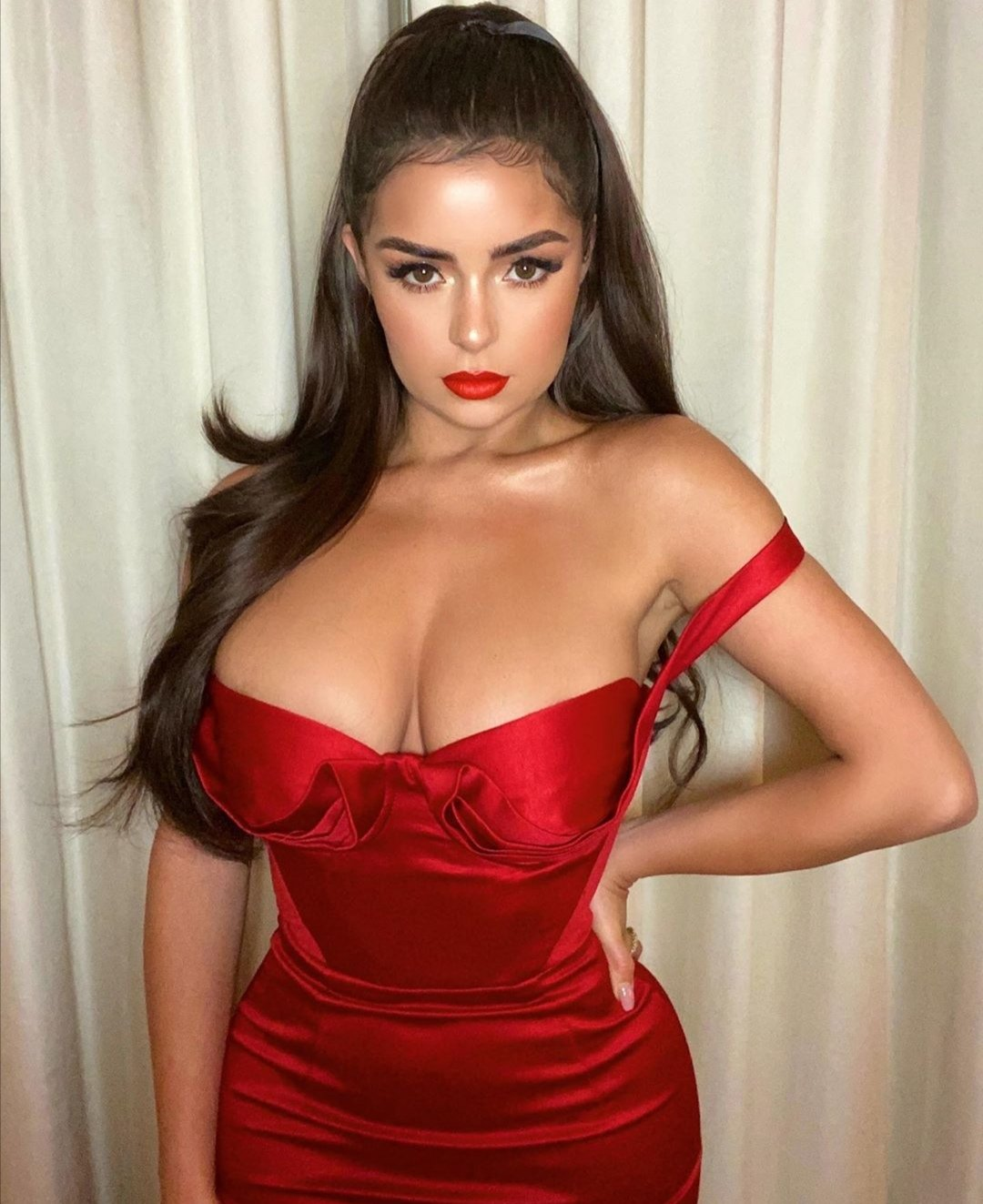 Demi Rose sets pulses racing in a plunging crimson gown at Christmas bash