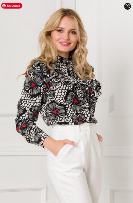 Bluza neagra cu imprimeuri florale discrete si volane la bust