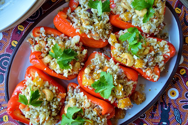 A plate of peppers stuffed with vegetable cauliflower rice