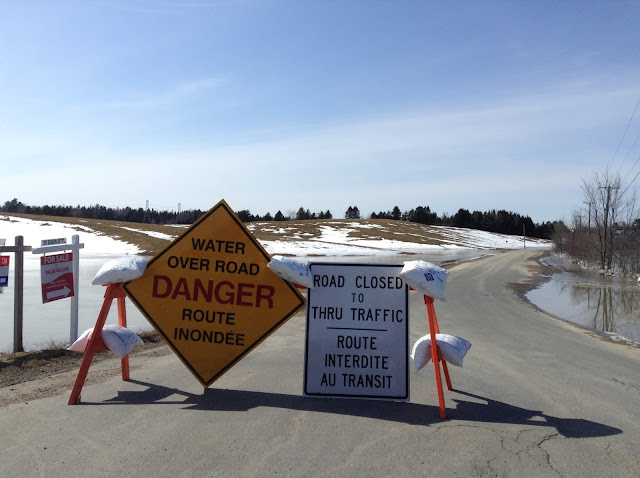 signs for road closure due to spring flooding