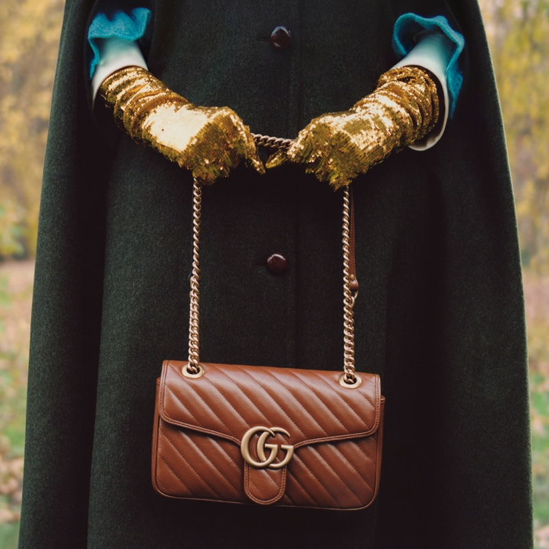 Singer Celeste poses with Gucci GG Marmont bag.