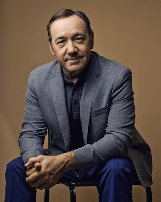 Kevin Spacey Sitting Smiling