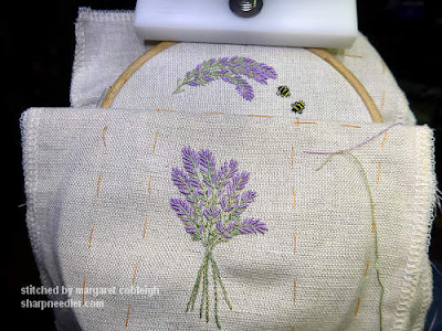 An embroidered lavender bunch along with a lavender spray and two bees. These are the required embroidery elements for the Lavender and Bees Scissors Keeper.