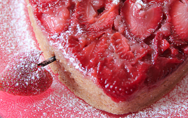 Close up of Cupid's arrow going through the strawberry upside down cake.