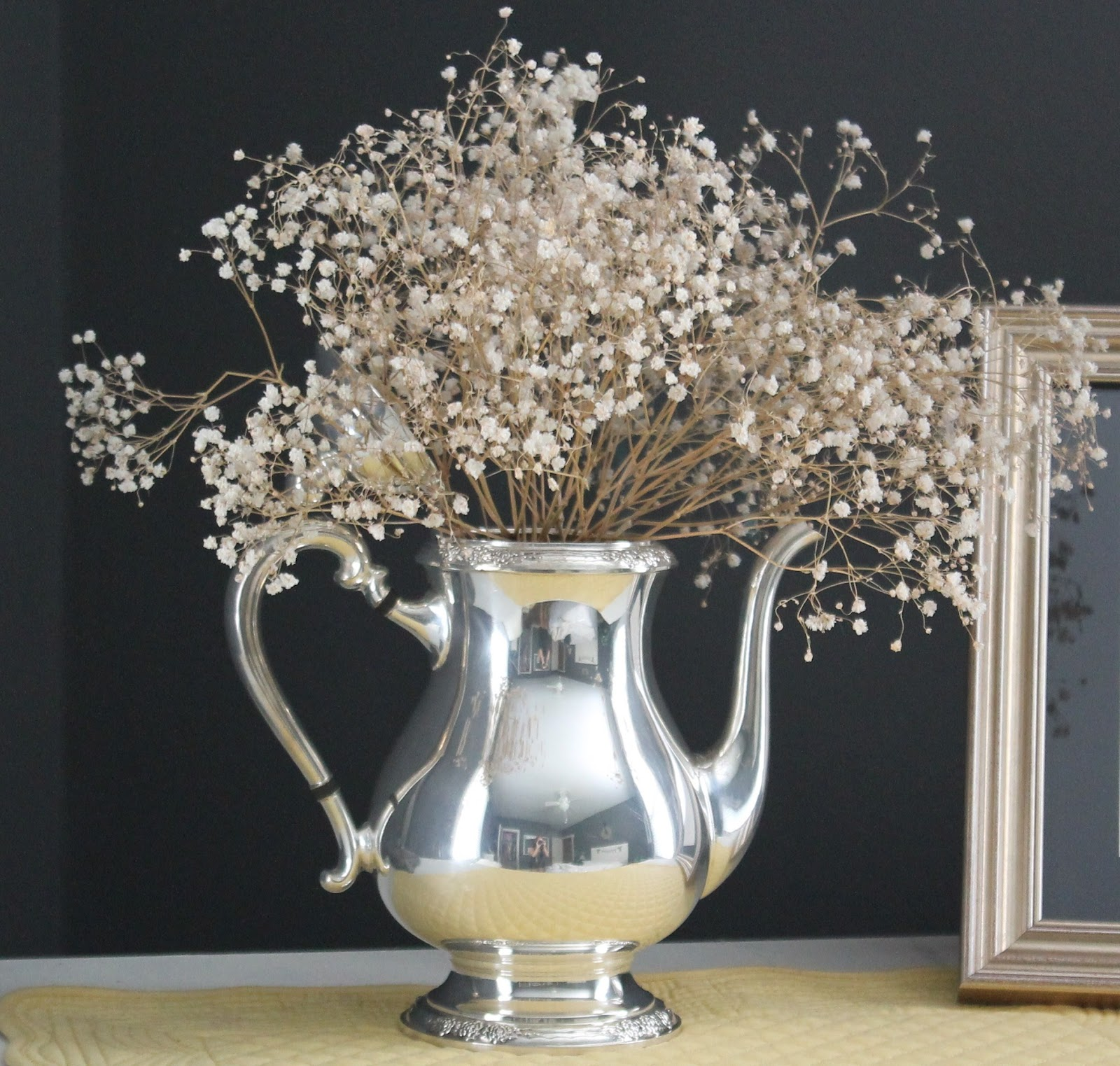 silver pitcher as vase