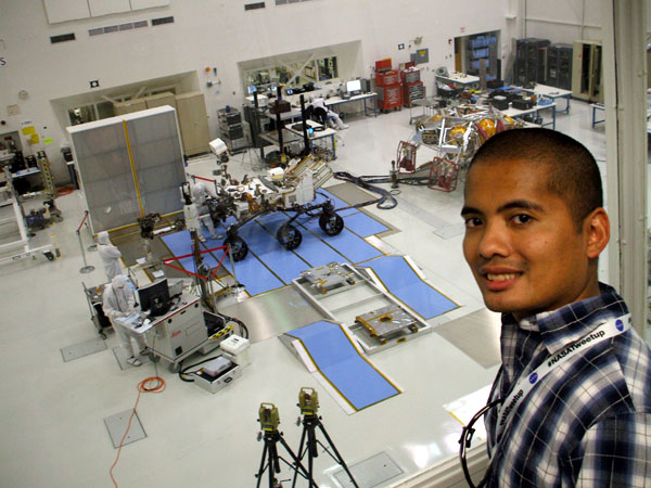 Posing with the Curiosity Mars rover and its descent stage behind me inside the Spacecraft Assembly Facility at NASA's Jet Propulsion Laboratory...on June 6, 2011.