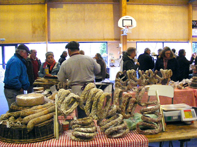 Dry cured sausages (aka saucisson or salami) on sale at a gourmet market.  Indre et Loire, France. Photographed by Susan Walter. Tour the Loire Valley with a classic car and a private guide.