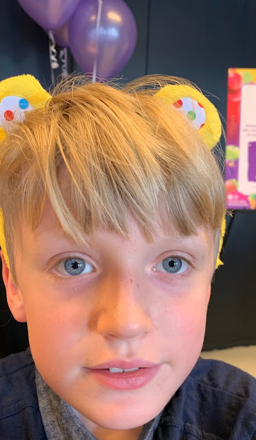autistic boy wearing Pudsey Bear Ears