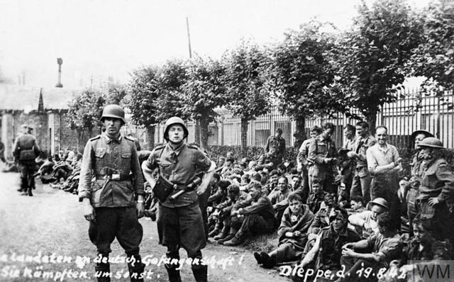 Allied prisoners under guard after the Dieppe raid worldwartwo.filminspector.com