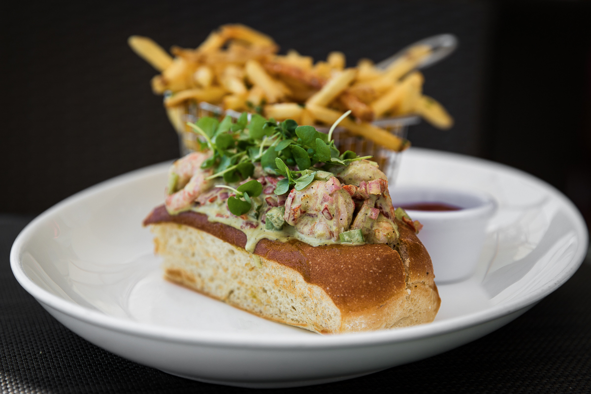 Shrimp roll with basil aioli on a sweet roll.