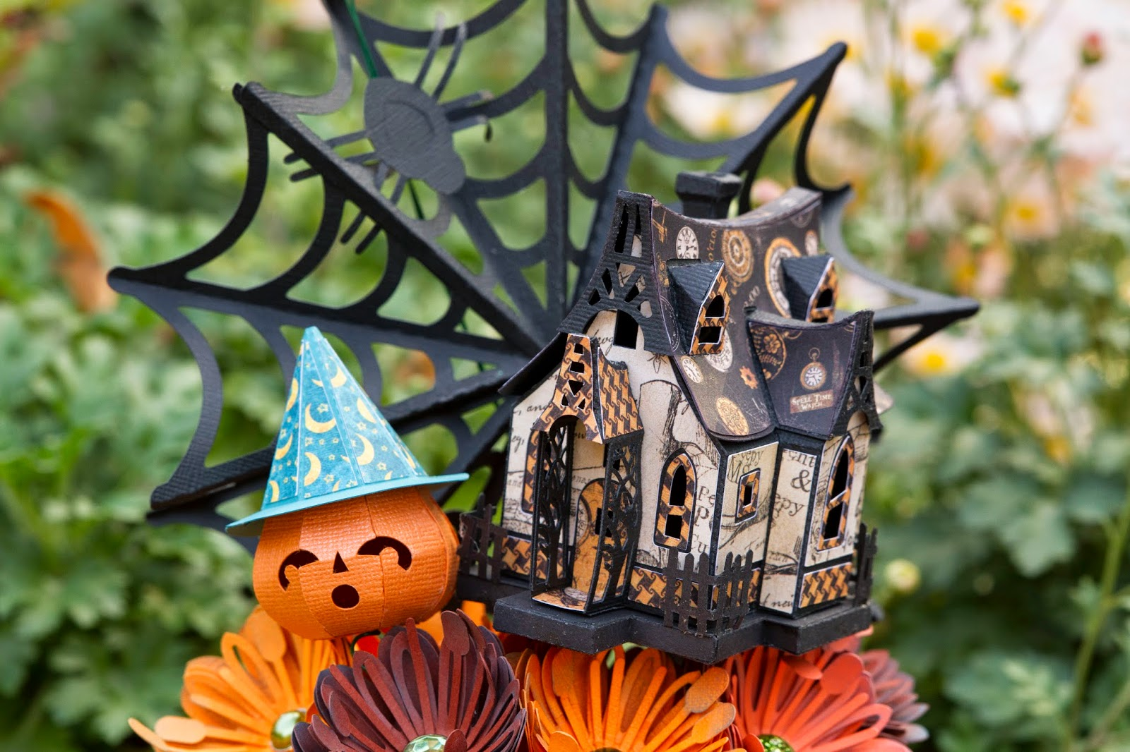 Close up of pumpkin, witches house and spiderweb