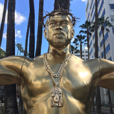 SEE THE KANYE WEST STATUE ON A CRUCIFIX ON HOLLYWOOD BOULEVARD THAT HAS GOT PEOPLE TALKING