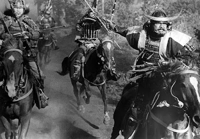 "Toshirô Mifune and Akira Kubo charge into battle on horses in Akira Kurosawa's 1957 film ""Throne of Blood."""