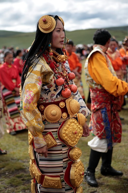 Woman from Kham region of China wearing traditional costume and jewelry during festival