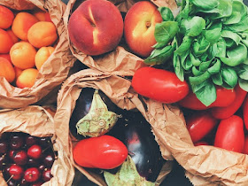 Paper bags filled with fruits and vegetables