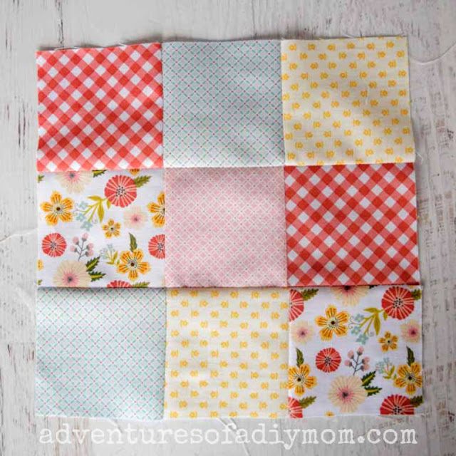 nine patch quilt block with a variety of colored fabrics