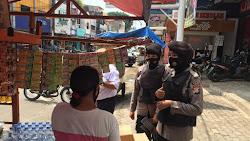 Aksi Nong Jawara Polda Banten Dalam Mencegah Penyebaran Covid-19 di Pasar Royal Serang