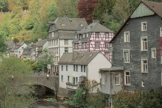 The look from afar on old buildings and river in Monschau, Germany