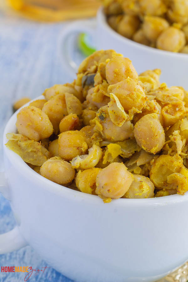 Close up of curry chicpea in a white cup