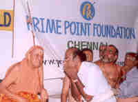 His Holiness Sri Kanchi Sankaracharya Swamigal listening to K. Srinivasan