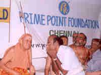 His Holiness Sri Kanchi Sankaracharya Swamigal listening to K. Srinivasan