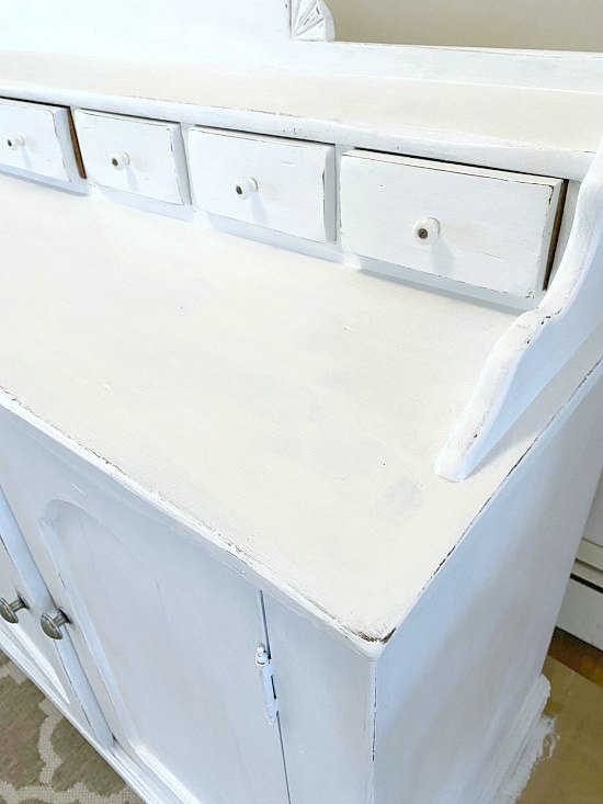 A white painted sideboard with farmhouse style
