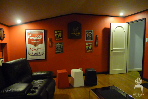 red wall man cave with wall art