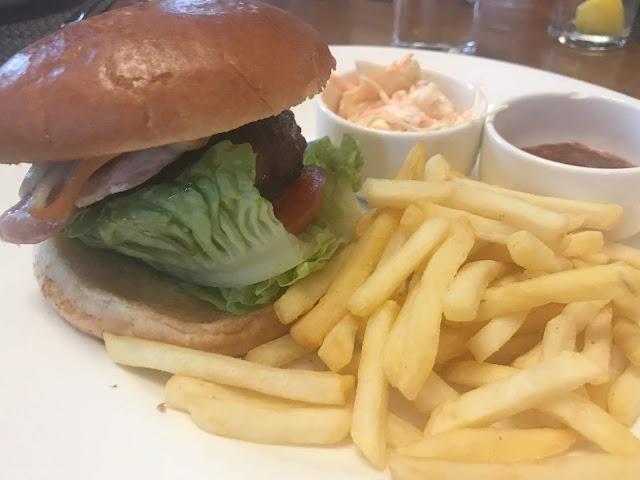 beef burger bun with salad, fries, coleslaw and pot relish