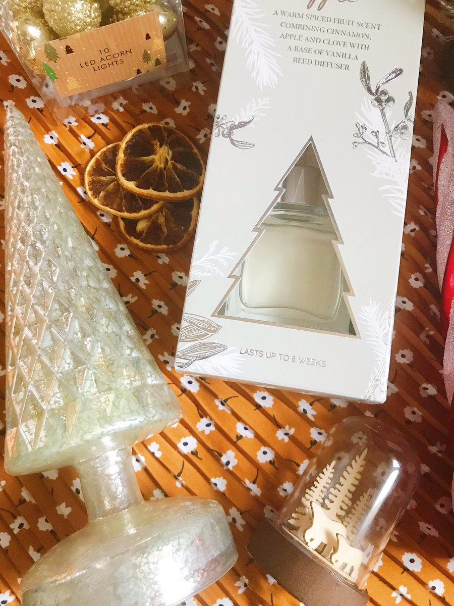 flatlay - closeup of light up tree, reed diffuser and light up globe