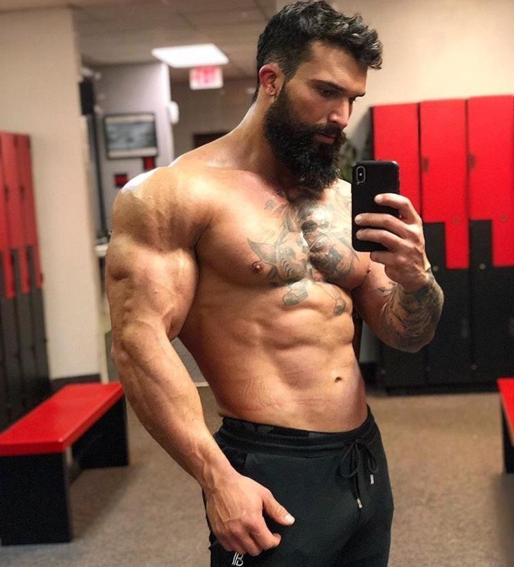 shirtless-huge-muscle-hunk-sexy-bearded-lumberjack-dark-young-man-big-biceps-tattoo-fit-swole-beefcake-body-gym-locker-room-selfie