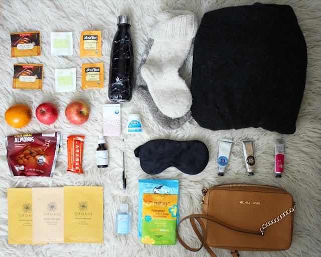 Travel essential items flatlay